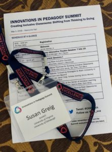 A photo of my name badge and the programme for the Innovations In Pedagogy Summit UVa